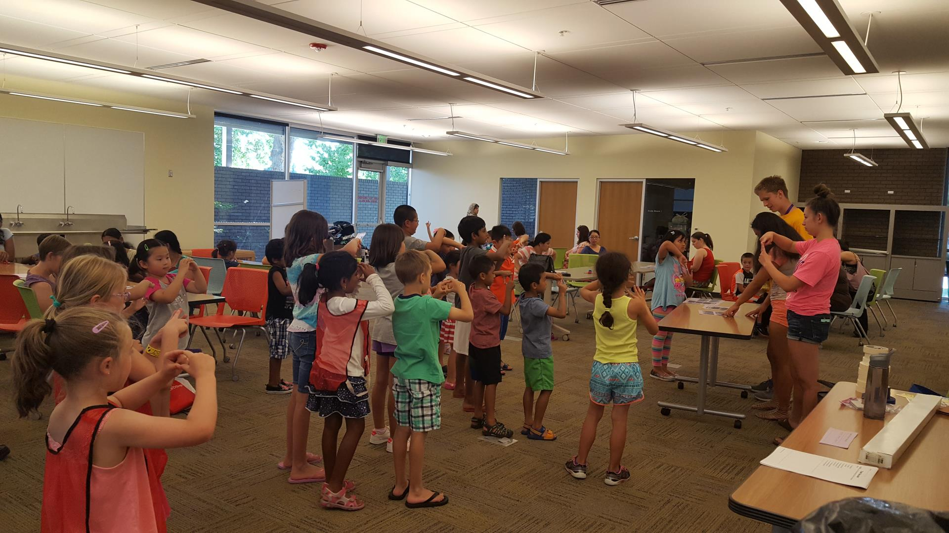 Children participate in a game of Geometric Shapes Simon Says