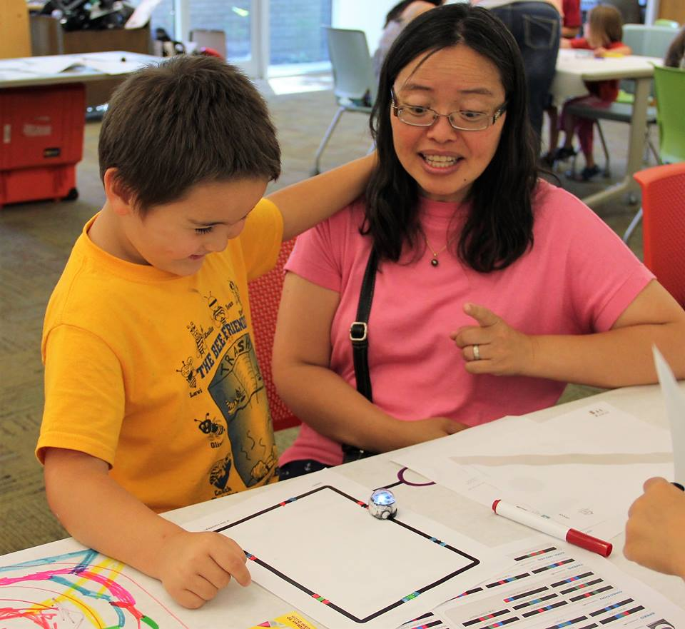 Mother and son learn to program Ozobots using color codes