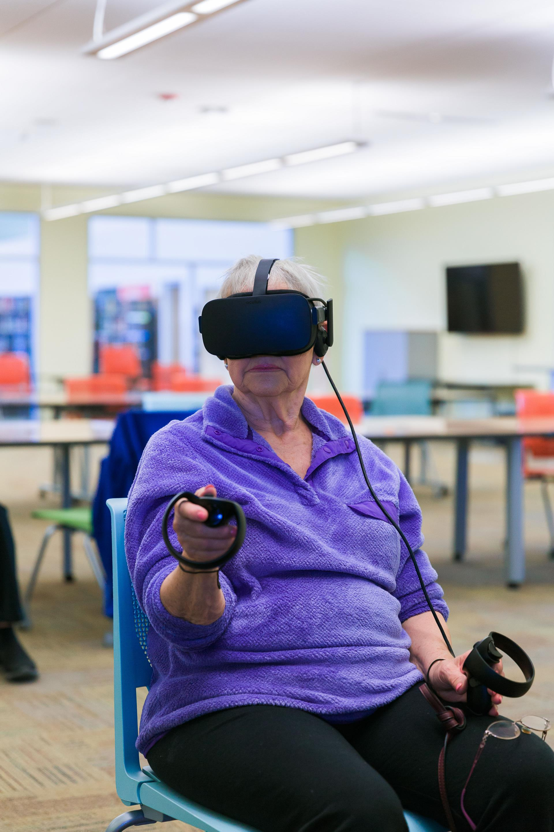 Woman using virtual reality headset and controllers