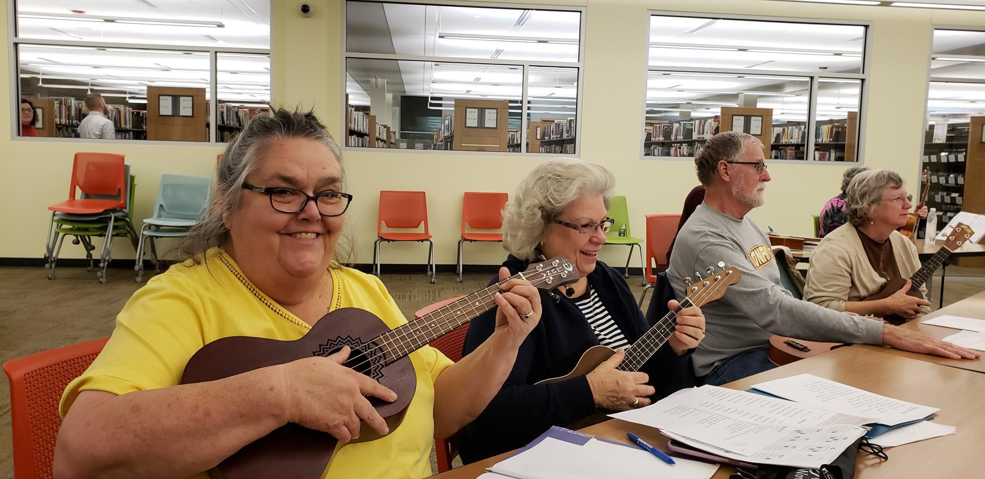 Ladies playing ukuleles in the Library STEAMspace