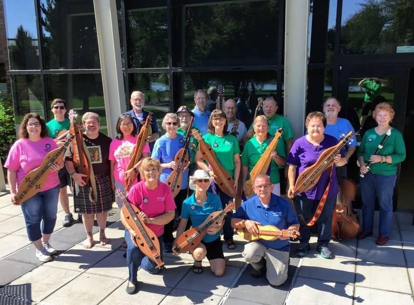 Group photo of dulcimer society members with their instruments